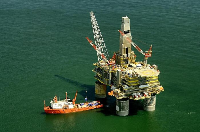 commercial-ship-approaching-oil-rig-russian-seas-preparing-for-oil-and-gas-safety-inspection