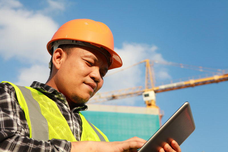 Construction Site worker using a Quality Management App