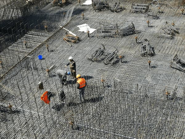 Workers inspecting quality control in construction on a jobsite